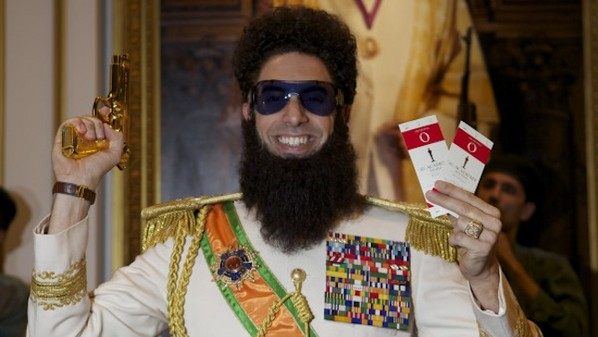 Sacha Baron Cohen Tweets Photo With Oscar Tickets and Gun: 'VICTORY!'